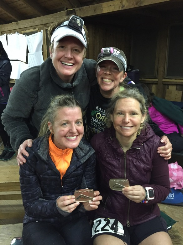 Umstead 100! The happy finishers Jenica and Janet with Happy pacers, Myself and Carol!